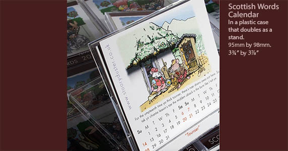 Scottish word illustrated calendar in its case standing up.